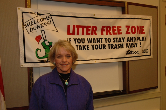 [Assignment: 48-DPA-N_BLM_Banner_12-5-05] Bureau of Land Management Director Kathleen Clarke [standing in front of anti-littering] banner,  [Main Interior] [48-DPA-N_BLM_Banner_12-5-05_DOI_3559.JPG]