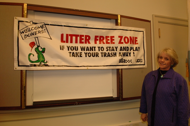 [Assignment: 48-DPA-N_BLM_Banner_12-5-05] Bureau of Land Management Director Kathleen Clarke [standing in front of anti-littering] banner,  [Main Interior] [48-DPA-N_BLM_Banner_12-5-05_DOI_3563.JPG]