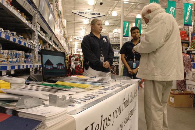 [Hurricane Katrina] D'Iberville, Miss., December 6, 2005 -- FEMA representatives Debra Badeaux (left) and Bertha Hoskins (center) explain mitigation techniques at a local home improvement store.  FEMA encourages residents of Mississippi to rebuild smarter and stronger.  Mark Wolfe/FEMA