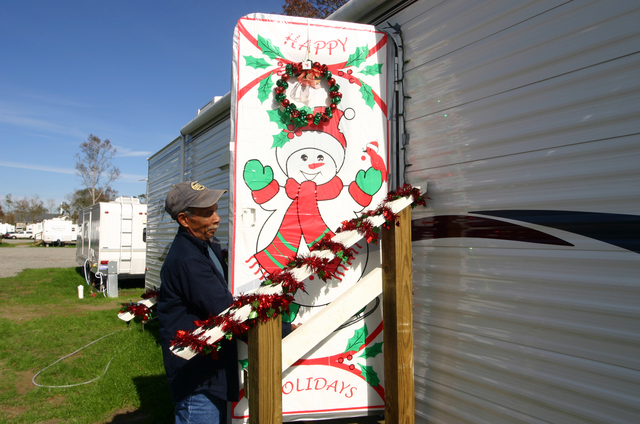 [Hurricane Katrina/Hurricane Rita] Baker, LA  December 6, 2005 - Emmette Sylve lost his Plaquemines Parish home to Hurricane Katrina, but he didn't lose his Christmas spirit.  He and his wife decorated their FEMA trailer to make it feel more like home for the holidays.  Photo by Greg Henshall / FEMA