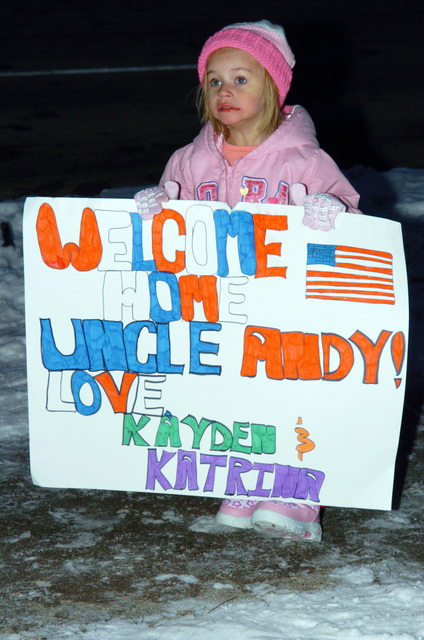 A family member of a US Army Soldier assigned to the 1073rd Maintenance Company, Michigan Army National Guard (MIARNG), proudly displays her welcome home sign, as she awaits the return of her uncle Andy, returning home at Greenville, Michigan (MI), following a one year tour of duty in Iraq. (A3596)