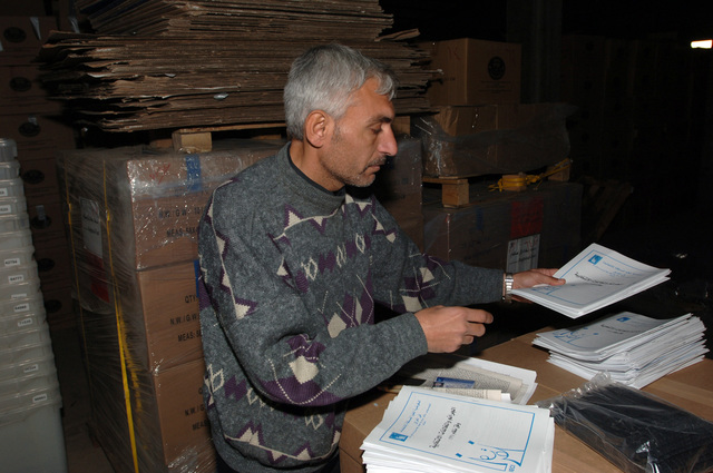 An Iraqi election official verified that all the ballots were in good condition before being loaded into the trucks.(U.S. Army photo by SPC. Teddy Wade) (Released)