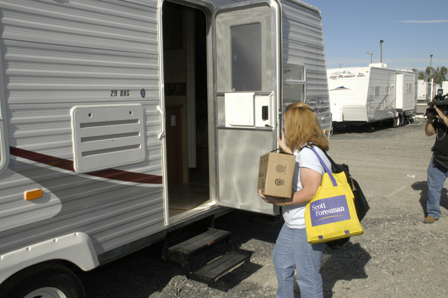 [Hurricane Katrina] New Orleans, LA, 12-12-05 -- Kindergarden Teacher Angel Chism moves in to her new FEMA Travel Trailer.  Jefferson Parish schools and FEMA teamed together to provide Travel Trailer  housing for its school teachers that are victims of Hurricane Katrina.  MARVIN NAUMAN/FEMA photo