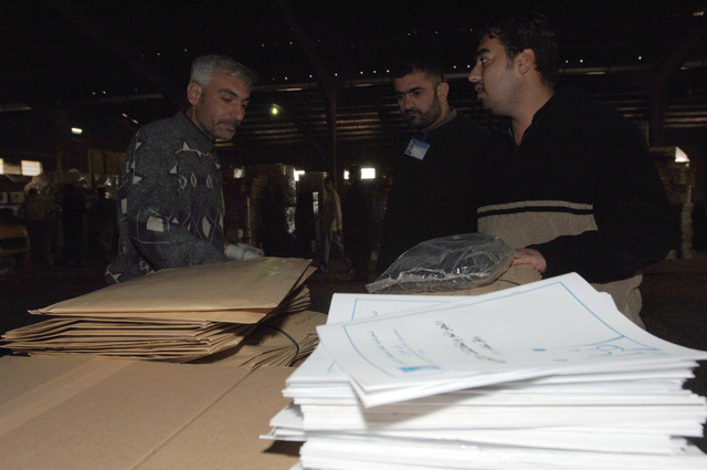 Iraqi election officials verified that all the ballots were in good condition before being loaded into the trucks.(U.S. Army photo by SPC. Teddy Wade) (Released)