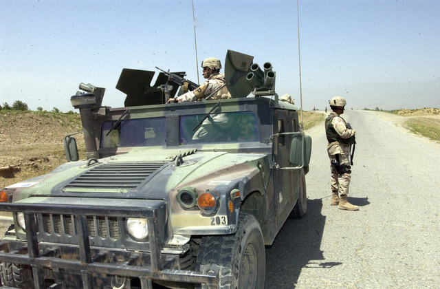 Iraqi soldiers from 3rd Company, 3rd Battalion, 1ST Brigade, Samarra, Iraq unload their equipment to prepare to stand guard at the Al Khulufia election polling site in the western outer limits of Samarra, Iraq.  The Iraqi soldiers will guard the election polling site during the Dec. 15, 2005 Iraqi National Elections.  (U.S. Army photo by STAFF SGT. Alfred Johnson) (Released)