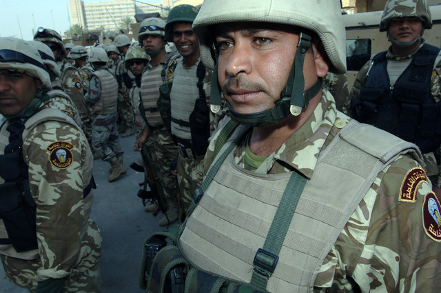 An Iraqi Soldier from the 6th Iraqi Army Division stand at attention during a formation, after providing security for the Iraqi permanent parliamentary elections on Dec. 15, 2005.  These elections will set the path to a future democracy in Iraq for the next four years.(U.S. Army photo by SPC. Teddy Wade) (Released)