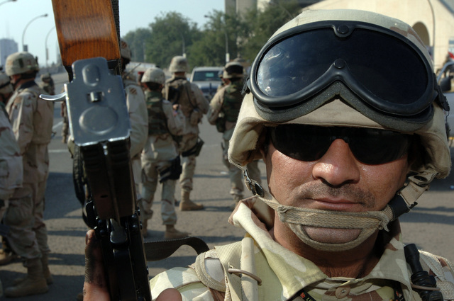 An Iraqi soldier provides security outside a polling site in East Baghdad during the Iraqi permanent parliamentary elections on Dec. 15, 2005.  These elections will set the path to a future democracy in Iraq for the next four years.(U.S. Army photo by SPC. Teddy Wade) (Released)