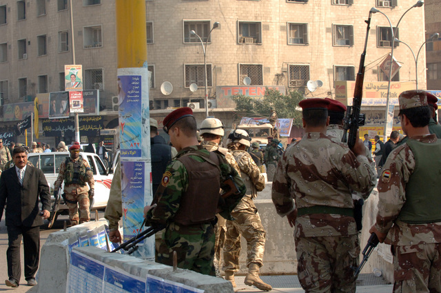 Iraqi Army soldiers guard the area around a polling center in Baghdad on election day. (U.S. Army photo by PFC. Nathaniel Lawrence) (Released)