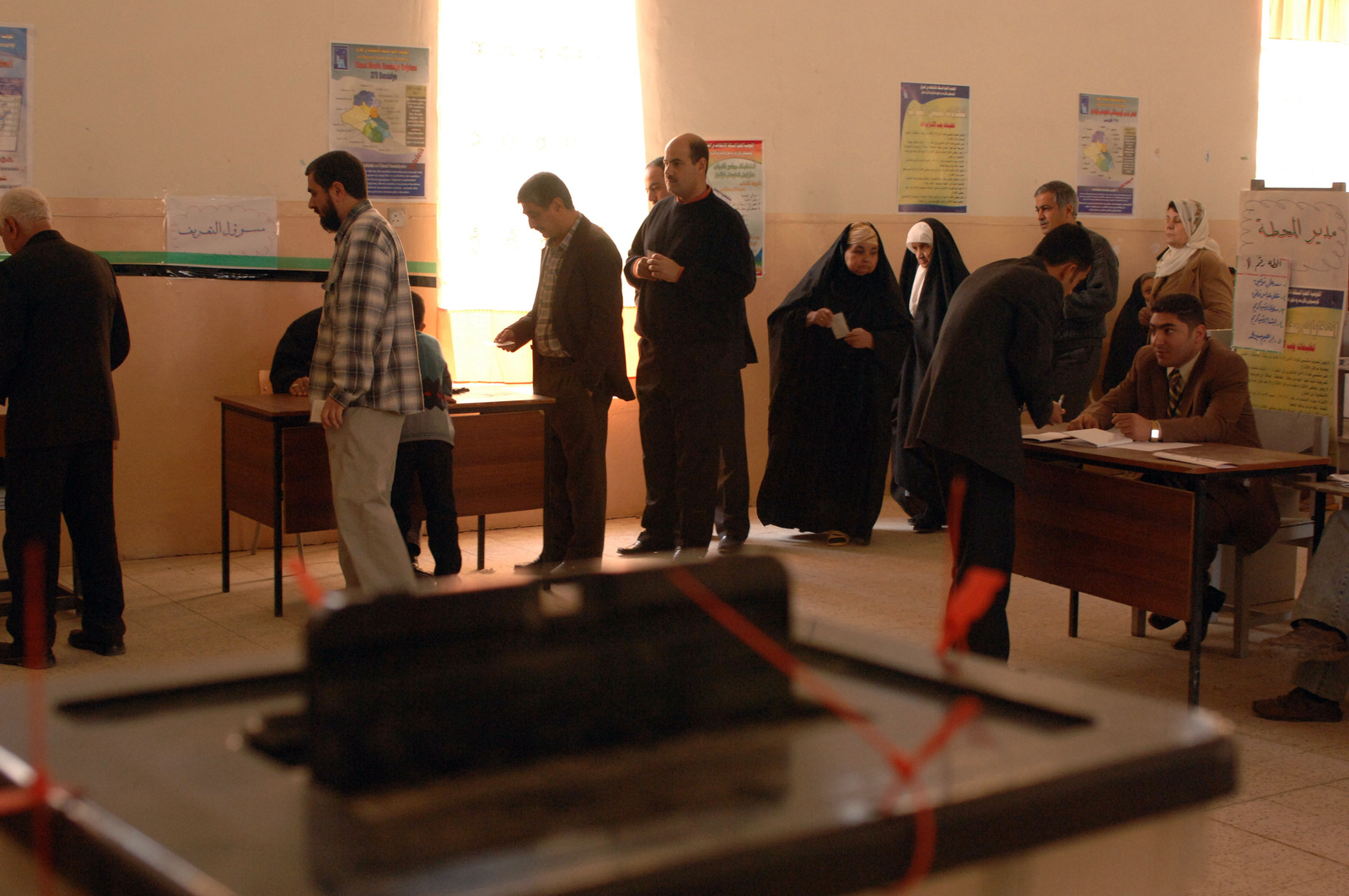 Iraqi citizens stand in line in a polling station in north central Iraq Dec. 15, 2005. Iraqis are electing their first permanent parliamentary government, which will lead this new democracy for the next four years. (U.S. Army photo by SPC. Timothy Kingston) (Released)