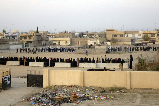 Iraqi citizens stand in line on the morning of their elections.  Mosul in Support of Operation Iraqi Freedom. (U.S. Army photo by STAFF SGT. James H. Christopher III) (Released)