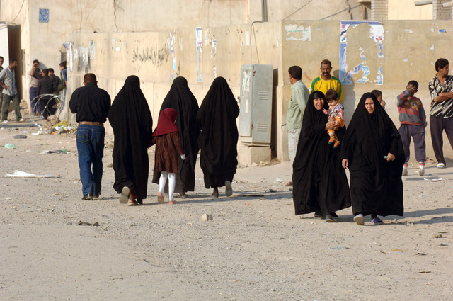Iraqi family heads towards the voting station to vote during the elections, on Dec. 15, 2005, downtown Baghdad.  The elections are the first free elections ever conducted for the perment parlimentary government in Iraq.   (U.S. Army photo by PFC. William Servinski II) (Released)