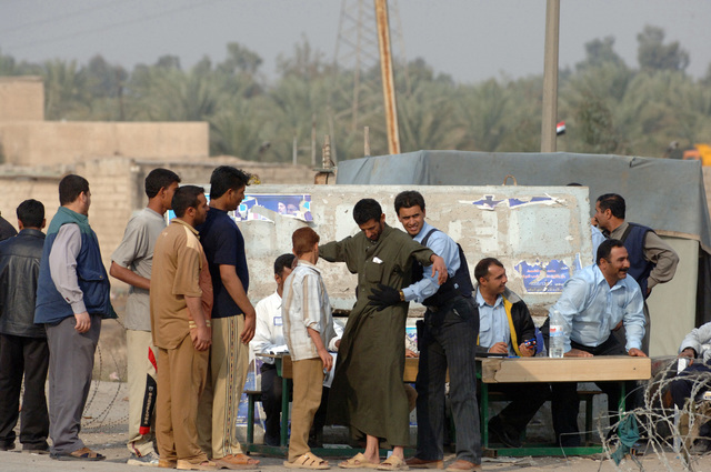 Iraqi police are mobilized to polling sites in Iraq's first official democratic elections Dec. 15, 2005. The Iraqi Police as well as the Iraqi Army were scheduled to vote earlier than the rest of the populace in order to provide added security during Iraq's general elections.(U.S. Army photo by PVT. Ronald R. Gaete) (Released)