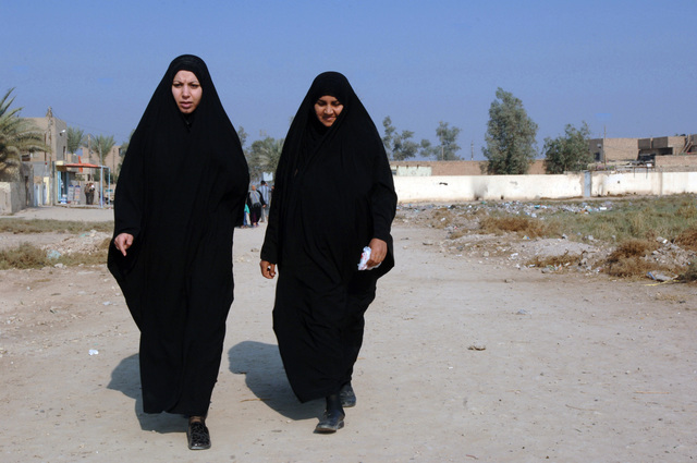 Iraqi women walk toward a polling site during the Iraqi permanent parliamentary elections in the Zafaraniyah district in Baghdad, Iraq on Dec. 15, 2005. These elections will set the path to a future democracy in Iraq for the next four years.(U.S. Army photo by SPC. Teddy Wade) (Released)