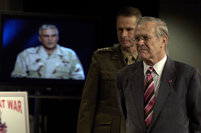 The Honorable Donald H. Rumsfeld (right), U.S. Secretary of Defense, and U.S. Marine Corps GEN. Peter Pace, Chairman of the Joint Chiefs of STAFF, listen as U.S. Army George W. Casey, Jr., Commander, Multinational Force-Iraq, describes the success of the Iraqi elections via satellite feed at a Town Hall Meeting at the Pentagon, Washington, D.C., Dec. 15, 2005.  (DoD photo by PETTY Officer 1ST Class Chad J. McNeeley) (Released)