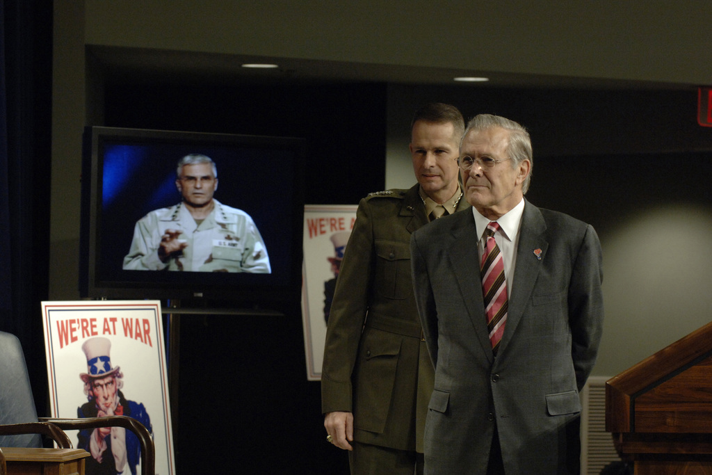 The Honorable Donald H. Rumsfeld (right), U.S. Secretary of Defense, and U.S. Marine Corps GEN. Peter Pace, Chairman of the Joint Chiefs of STAFF, listen as U.S. Army George W. Casey, Commander, Multinational Force-Iraq, describes the success of the Iraqi elections via satellite feed at a Town Hall Meeting at the Pentagon, Washington, D.C., Dec. 15, 2005.  (DoD photo by Helene C. Stikkel) (Released)