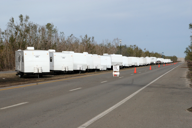 [Hurricane Katrina] Violet, LA, December 16, 2005 - These FEMA travel trailers are being set up on East Judge Perez Drive in St. Bernard Parish just east of the Violet Canal. The site will be erected on the actual west-bound lanes of the highway and will affect approximately a one mile stretch of the roadway.  Robert Kaufmann/FEMA
