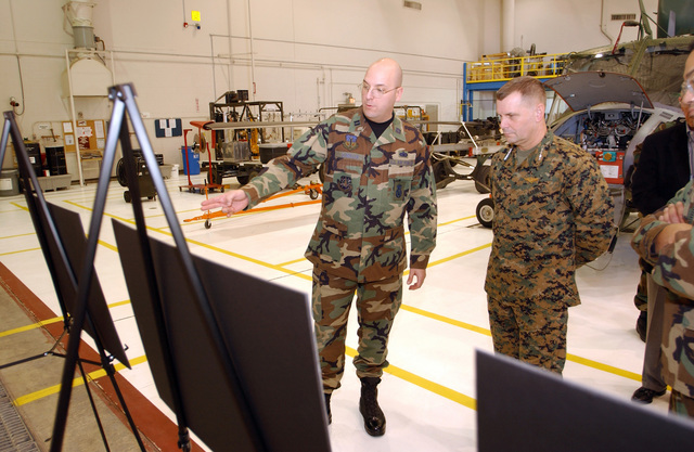 U.S. Marine Corps General James E. Cartwright (right), Commander of the U.S. Strategic Command, listens while U.S. Air Force CAPT. Louis J. Cubellis Jr., from the 341st Security Forces Group, gives a briefing during his visit at Malmstrom Air Force Base, Mont., on Dec. 17, 2004. GEN. Cartwright is at Malmstrom AFB to award the 341st Space Wing here with the 2003 Omaha Intercontinental Ballistic Missile Command Trophy. (USAF PHOTO by Roger Dey, CIV) (Released)