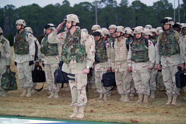 U.S. Army MAJ. David E. McCulley (saluting) and fellow Soldiers of the 3rd Infantry Division stand in formation on Cottrell Field, Fort Stewart, Ga., on Dec. 18, 2005, after returning from a yearlong tour of duty overseas in the Middle East. (U.S. Army photo by Catherine Johnson) (Released)