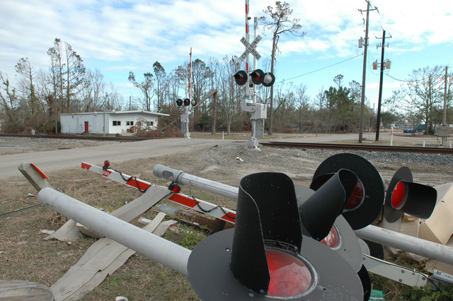 [Hurricane Katrina] Pass Christian, Miss., December 21, 2005 -- Railroad crossings in Pass Christian are being repaired in anticipation of trains running once again.  Pass Christian was devastated by Hurricane Katrina.  Mark Wolfe/FEMA