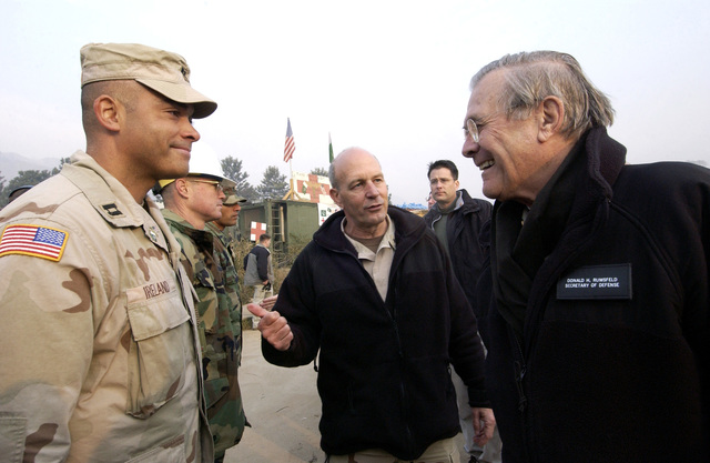 The Honorable Donald H. Rumsfeld (right), U.S. Secretary of Defense, and U.S. Navy Rear Adm. Michael LeFever (center), Commander, Disaster Assistance Center Pakistan, visit U.S. military service members at Muzaffarabad, Azad Kashmir Region, Pakistan, on Dec. 21, 2005. These service members are participating in Operation Lifeline, the Pakistani-led relief operation to aid the victims of the devastating earthquake that hit the area on Oct. 8, 2005. (DoD photo by AIRMAN 1ST Class Barry Loo) (Released)
