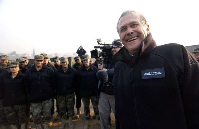The Honorable Donald H. Rumsfeld (right), U.S. Secretary of Defense, visits with U.S. military service members at Muzaffarabad, Azad Kashmir Region, Pakistan, on Dec. 21, 2005, who are participating in Operation Lifeline, the Pakistani-led relief operation to aid the victims of the devastating earthquake that hit the area on Oct. 8, 2005. (DoD photo by AIRMAN 1ST Class Barry Loo) (Released)