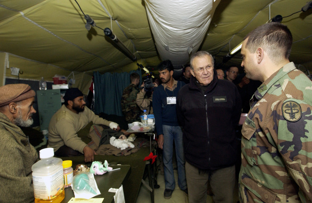 The Honorable Donald H. Rumsfeld (second from right), U.S. Secretary of Defense, speaks with a U.S. Army 212th Mobile Army Surgical Hospital (MASH) Soldier (right) about the two Pakistani patients being cared for by his unit at Muzaffarabad, Azad Kashmir Region, Pakistan, on Dec. 21, 2005. The 212th MASH is participating in Operation Lifeline, the Pakistani-led relief operation to aid the victims of the devastating earthquake that hit the area on Oct. 8, 2005. (DoD photo by AIRMAN 1ST Class Barry Loo) (Released)