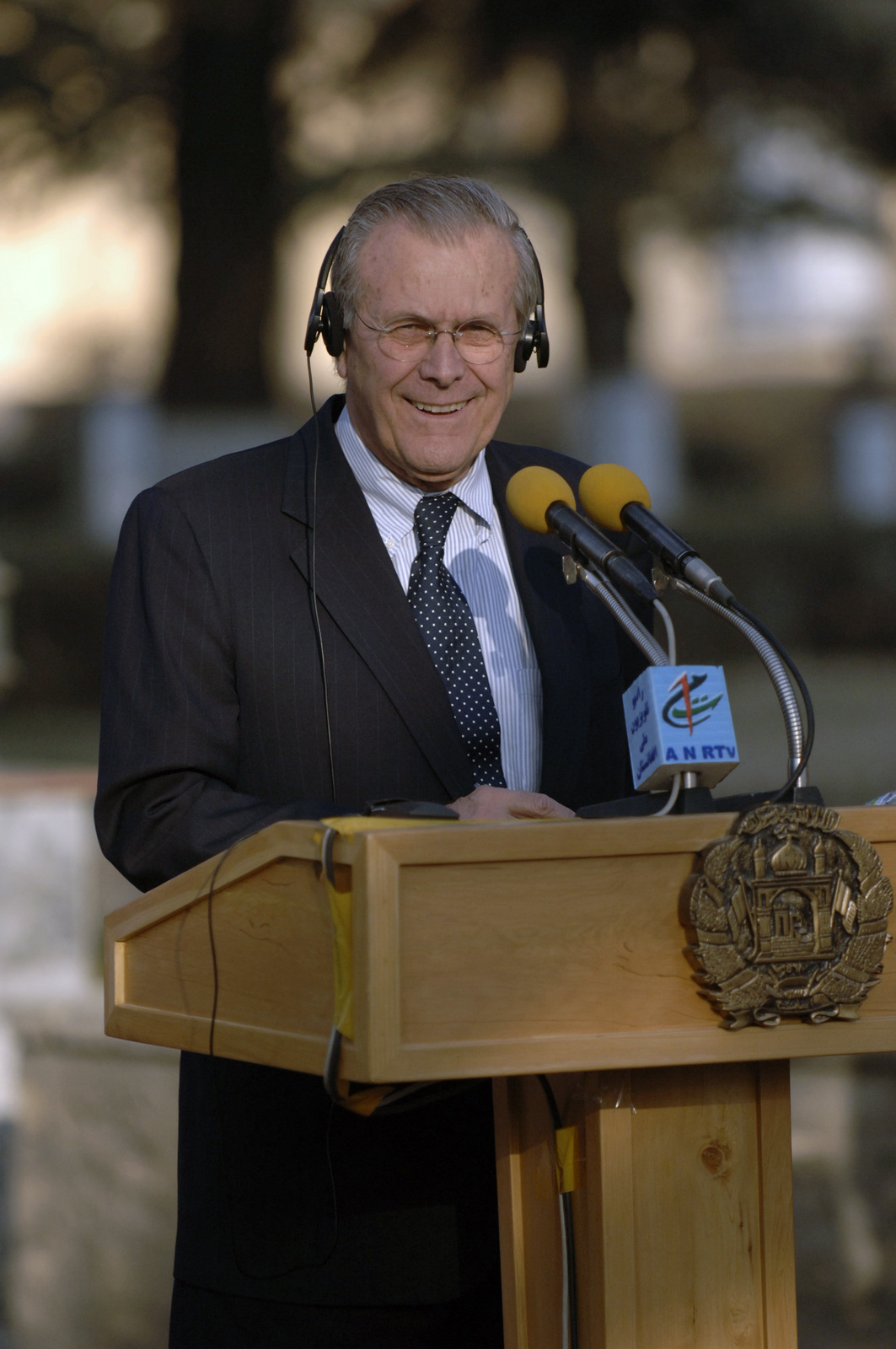 The Honorable Donald H. Rumsfeld, U.S. Secretary of Defense (SECDEF), responds to questions at a joint press conference with Hamad Karzai, President of Afghanistan, in Kabul, Afghanistan, Dec. 21, 2005, announcing U.S. Troop reduction in the area.  The SECDEF is in country after visiting the affected areas of the Oct. 8, 2005 earthquake in Pakistan and to support the U.S. Service Members of the region.  (DoD photo by PETTY Officer 1ST Class Chad J. McNeeley) (Released)