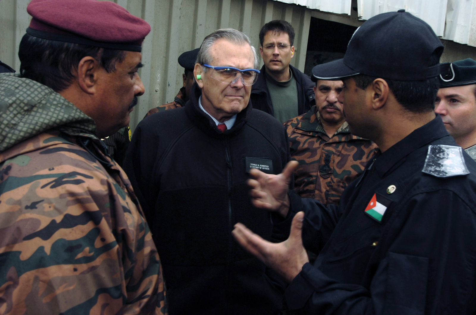 The Honorable Donald H. Rumsfeld (center), U.S. Secretary of Defense (SECDEF), is briefed by Jordanian Special Operations Forces about the capabilities of the Jordanian anti-terrorism training program at the King Abdullah II Special Operations Training Center (KASOTC), Dec.23, 2005.  The SECDEF is in country to visit the KASOTC after visiting the affected areas of the Oct. 8, 2005 earthquake in Pakistan and to support the U.S. Service Members of the region.  (DoD photo by PETTY Officer 1ST Class Chad J. McNeeley) (Released)