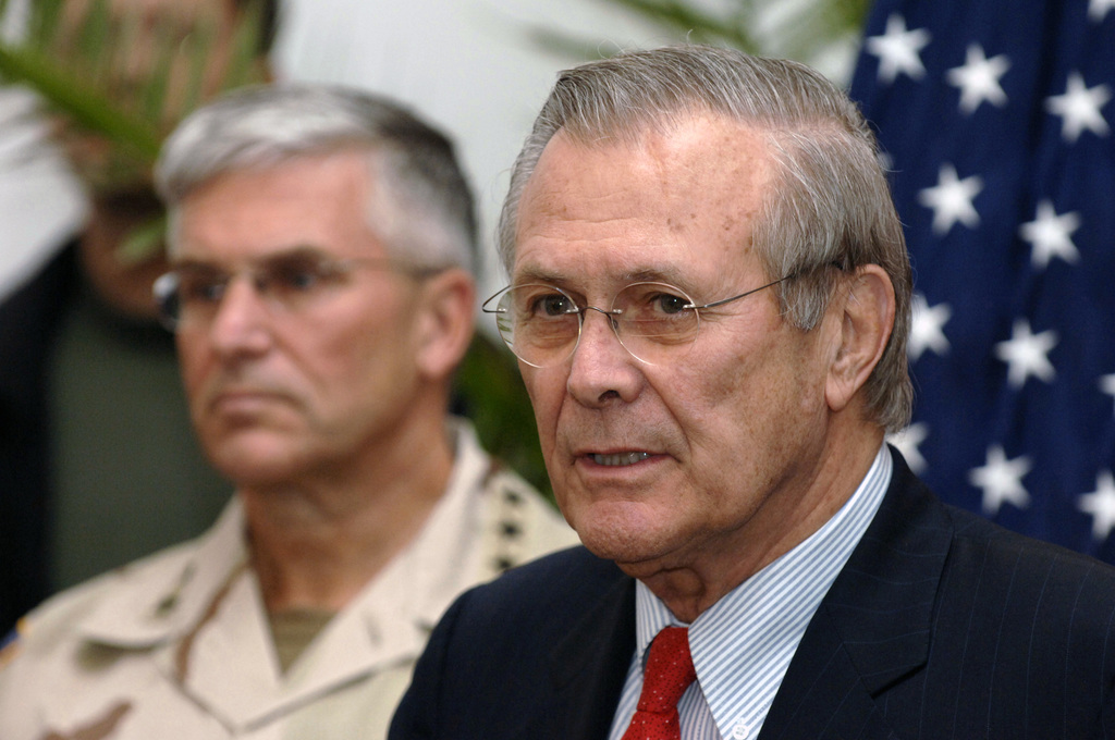 The Honorable Donald H. Rumsfeld (right), U.S. Secretary of Defense (SECDEF), responds to the media at a press briefing at the Presidential Palace in Baghdad, Iraq, Dec. 23, 2005.  The SECDEF is in country after visiting the affected areas of the Oct. 8, 2005 earthquake in Pakistan and to support the U.S. Service Members of the region.  U.S. Army GEN. George W. Casey, Jr., Commander, Multi-National Force-Iraq, can be seen in the background.  (DoD photo by PETTY Officer 1ST Class Chad J. McNeeley) (Released)