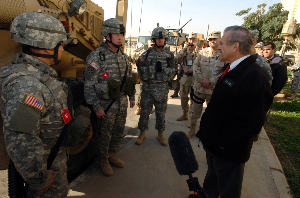 The Honorable Donald H. Rumsfeld (left), U.S. Secretary of Defense (SECDEF), greets U.S. Army Soldiers from Task Force Iron Claw at the Al-Faw Palace, Baghdad, Iraq, Dec. 24, 2005.  The SECDEF is in country after visiting the affected areas of the Oct. 8, 2005 earthquake in Pakistan and to support the U.S. Service Members of the region.  (DoD photo by PETTY Officer 1ST Class Chad J. McNeeley) (Released)