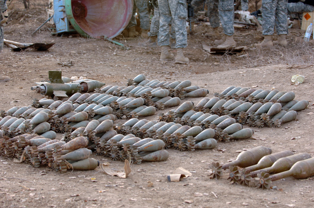 A massive weapons cache was found by U.S. Army Soldiers from 3rd Platoon, C Company, 1-327th Infantry Regiment, 101st Airborne Division, Fort Campbell, Ky., on Dec. 27, 2005. Approximately 280 mortars, 200 fuses and 200 14.5 mm rounds were extracted from a undergound pipe near Alsalana, Iraq. (U.S. Army photo by SPC. Timothy Kingston) (Released)