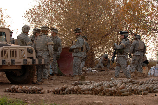 A massive weapons cache was found by U.S. Army Soldiers from 3rd Platoon, C Company, 1-327th Infantry Regiment, 101st Airborne Division, Fort Campbell, Ky., on Dec. 27, 2005. 280 mortars, 200 fuses and 200 14.5 mm rounds were extracted from a undergound pipe near Alsalana, Iraq. (U.S. Army photo by SPC. Timothy Kingston) (Released)