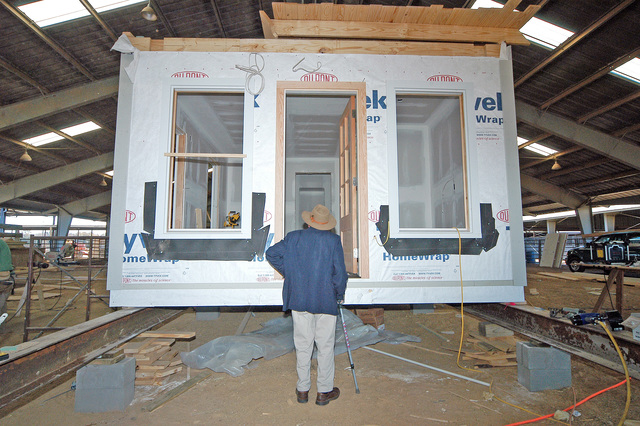 [Hurricane Katrina] Jackson, MS., December 29, 2005 - A person looks at a small modular home being constructed in Jackson, MS., by a non-profit group which plans to bring the house to a coastal town in Mississippi.  This house uses two sets of bunk beds and can accommodate up to four people.  Patsy Lynch/FEMA