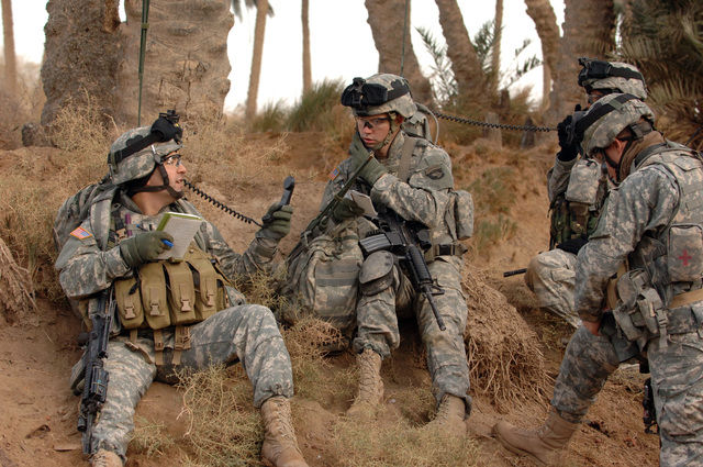 On Dec. 30, 2005 during the early morning hours soldiers from the 2nd Bn, 502nd INF, 2nd BCT, 101st ABN DIV (ASSLT) conducted Sweep and Search Operations in the Village of Shakaria, Iraq. (Left)1LT Ryan Crosby the company FSO took part on the mission.(U.S. Army photo by STAFF SGT. Kevin L. Moses Sr) (Released)
