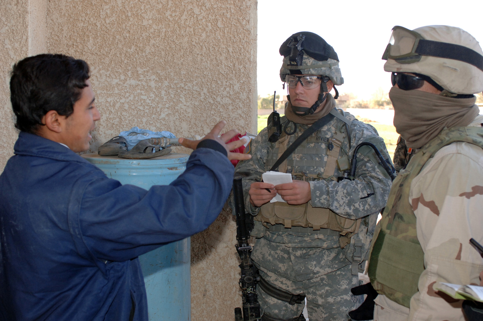 On Dec. 30, 2005 soldiers from Bravo Company, 2nd Bn, 502nd INF conducted Search and Sweep Operations in the Village of Shakaria, Iraq. CAPT. Andre Rivier, B Company Commander spoke with and greeted locales as he and his troops conducted operations in the Village.(U.S. Army photo by STAFF SGT. Kevin L. Moses Sr) (Released)