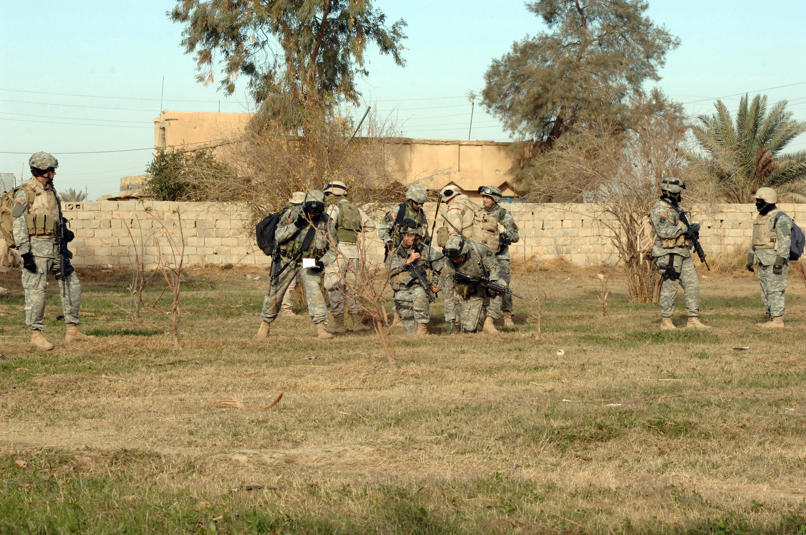 On Dec. 30, 2005 soldiers from Bravo Company, 2nd Bn, 502nd INF conducted Search and Sweep Operations in the Village of Shakaria, Iraq. CAPT. Andre Rivier, B Company Commander walked from house to house to talk with locales.(U.S. Army photo by STAFF SGT. Kevin L. Moses Sr) (Released)