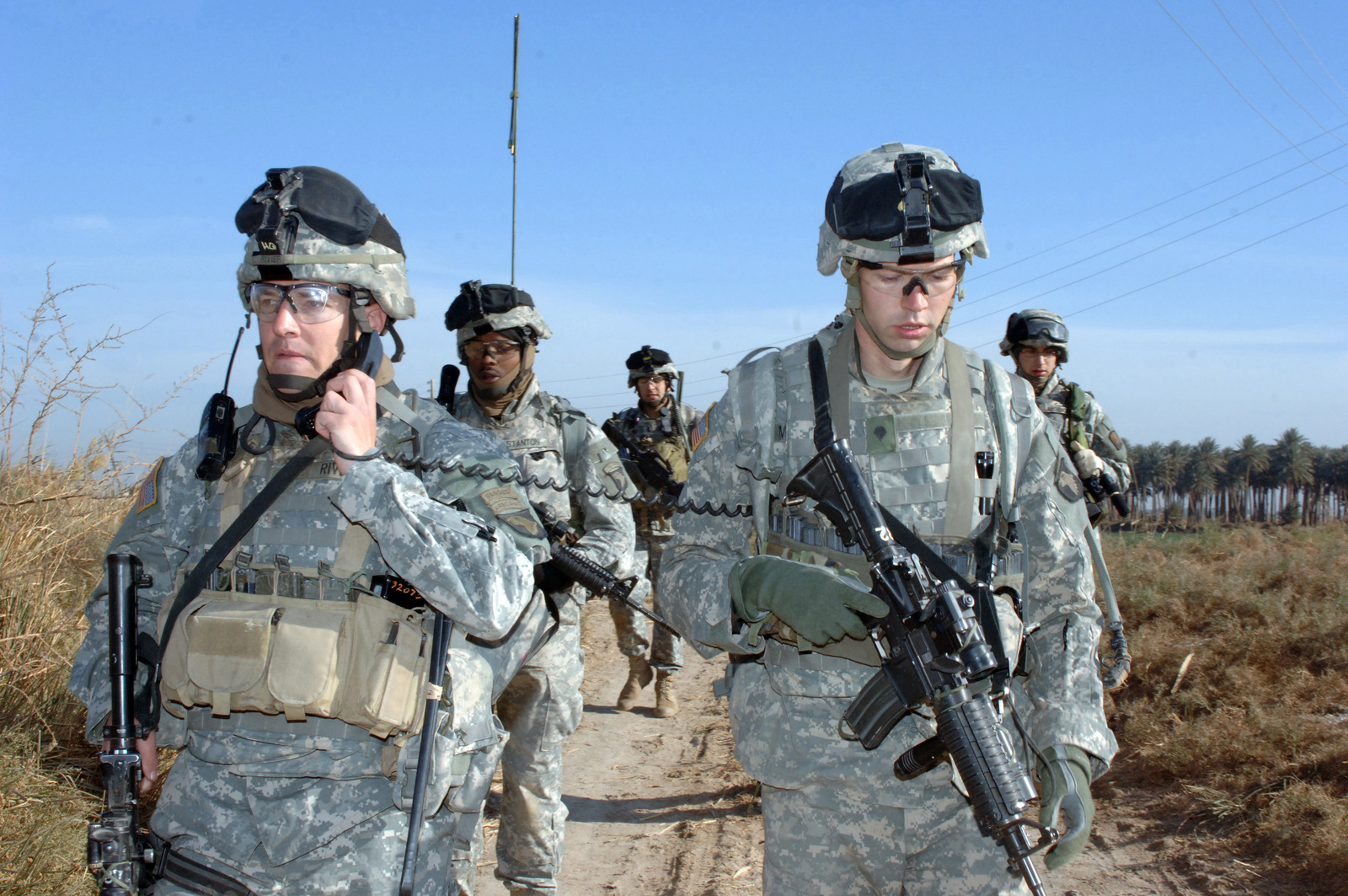 On Dec. 30, 2005 soldiers from Bravo Company, 2nd Bn, 502nd INF conducted Search and Sweep Operations in the Village of Shakaria, Iraq. (Left) CAPT. Andre Rivier, B Co Commander maintained communication with all elements during the operation.(U.S. Army photo by STAFF SGT. Kevin L. Moses Sr) (Released)