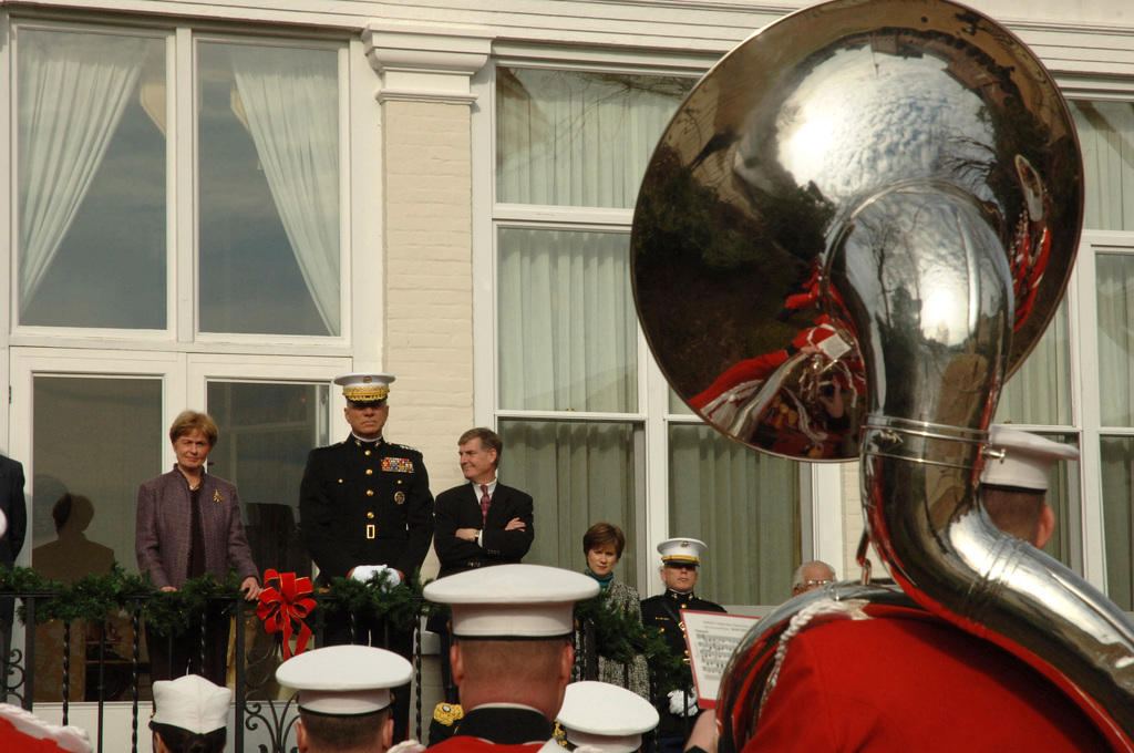 The President's Own, United States Marine Band serenades GEN. Michael W. Hagee, 33rd Commandant of the Marine Corps, and his spouse, Mrs. Silke Hagee, outside the Home of the Commandants in Washington, D.C. on Jan. 1, 2006. The New Year's Serendae is a tradional even started by the band with 7th Commandant of the Marine Corps.(U.S. Marine Corps photo by SGT. Christopher M. Tirado) (Released)