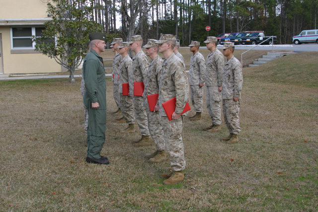 U.S. Marine Corps COL. Robert Lanham, Commanding Officer of Marine Corps Air Station Beaufort, S.C., presents six Marines from Disbursing with certificates of commendation. The Marine were recognized for their outstanding record and maintaining a high level of combat readiness while being severely shorthanded of manpower.  The certificates were awarded Jan. 6, 2006 aboard Marine Corps Air Station Beaufort, S.C. (U.S. Marine Corps photo by Lance CPL. Edward Z. Brown) (Released)