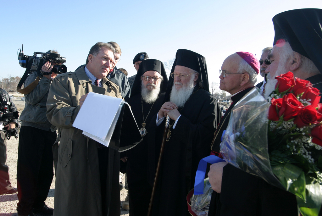 [Hurricane Katrina] New Orleans, LA  January 7, 2006 - Dan Hitchings, Director of Task Force Hope for the US Corps of Engineers, shows photos of the flood caused by Hurricane Katrina to Patriarch Bartholomew, head of the Greek Orthodox Church, and Roman Catholic Archbishop Hughes, at the site of the levee breech.  The Patriarch came to New Orleans for the first time ever to celebrate Greek Orthodox Christmas.  Photo by Greg Henshall / FEMA