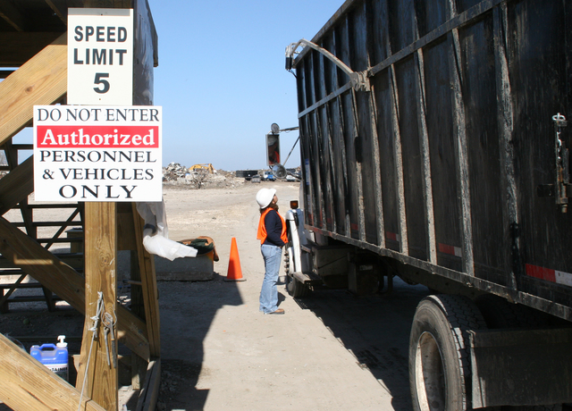 [Hurricane Rita] Cameron, LA, January 1, 2006 - A truck load of debris is examined as it enters the Wilkerson Disposal Site.  Cameron Parish is in the debris removal stage of recovery from Hurricane Rita, funded and supported by FEMA.  Robert Kaufmann/FEMA