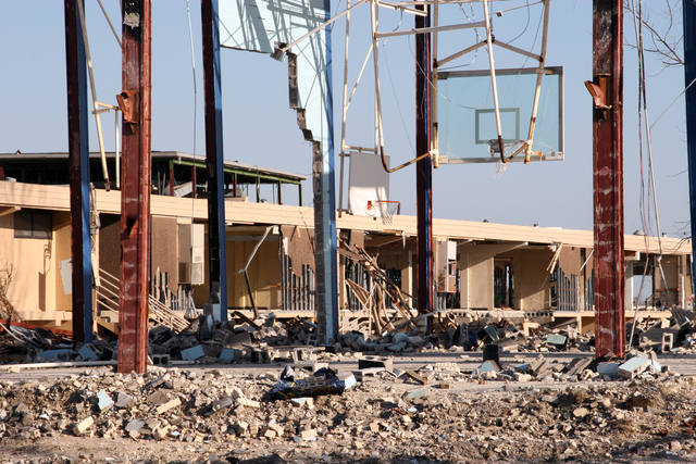[Hurricane Rita] Cameron, LA, January 11, 2006 - Only the steel frame and basketball rims of Cameron Elementary School's Gymnasium stand after Hurricane Rita ravaged Southwest Louisiana.  FEMA funds and supports the recovery efforts underway now in Cameron Parish.  Robert Kaufmann/FEMA