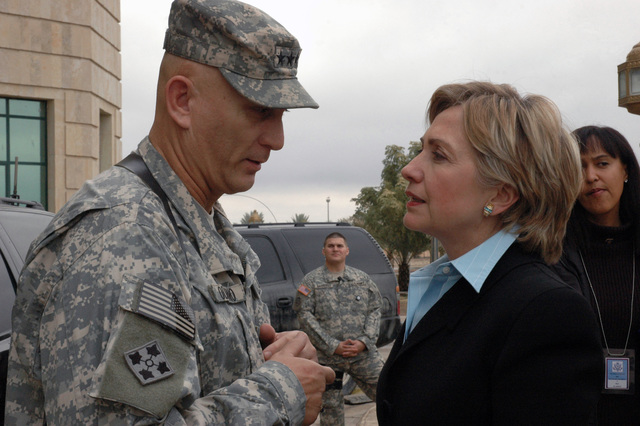 U.S. Army LT. GEN. Ray Odierno, Commander of the Multinational Corps, in Iraq and Sen. Hillary Rodham Clinton, (D-N.Y.), talk just outside of the Al Faw Palace.  Sen Clinton is visiting and part of a congressional delegation, which included Sen. Evan Bayh (D-Ind.) and Rep. John McHugh (R-N.Y.).  (U.S. Army PHOTO by SGT. Curt Cashour) (Released)