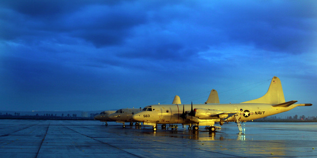 Three US Navy (USN) P-3C Orion maritime patrol aircraft, Patrol Squadron 26 (VP-26, Tridents), stand ready parked on the rain soaked flight line aboard Naval Air Station (NAS) Sigonella, Sicily, Italy (ITA), while on a six-month deployment to the Mediterranean to conduct Maritime Security Operations (MSO) in support of the Global war on Terrorism
