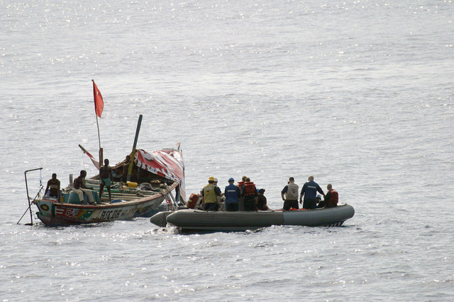 US Navy (USN) Sailors aboard a Rigid Hull Inflatable Boat (RIHB) from the USN Oliver Hazard Perry Class; Guided Missile Frigate, USS CARR (FFG 52) (not shown), come to the aid of distressed vessel off the coast of Sierra Leone, Africa. The small craft, with a crew of six men, had been at sea for 35 days and was without a working motor, food, or water. Within two hours, crew members dispatched from CARR had the vessel moving under its own power and had replenished supplies with enough food and fuel to get the vessel back to land safely