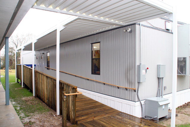 [Hurricane Katrina] Baton Rouge, LA, January 17, 2006 - This modular building was purchased by FEMA to be used as a temporary classroom at Audubon Elementary School in Baton Rouge for students that relocated from New Orleans after Hurricane Katrina.  FEMA has provided these buildings to several school districts to address the overcrowding issues in parishes that welcomed the hurricane victims.  Robert Kaufmann/FEMA