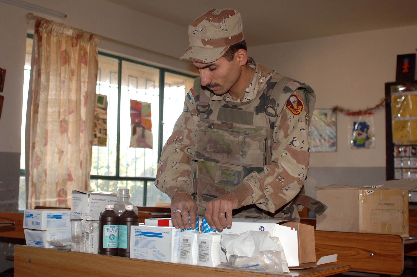 An Iraqi army soldier sets up various medicines at a medical civic action program (MEDCAP) for the local community, sponsored by Iraqi army soldiers from 1ST Battalion, 1ST Brigade, 6th Iraqi Division, at a school in western Baghdad, Iraq, Jan. 17, 2006. The purpose of the MEDCAP is to assist the community with free on the spot medical aid and provide much needed medicine to those who were previously unable to get medical treatment. (U.S. Army photo by STAFF SGT. Kevin L. Moses Sr.) (Released)