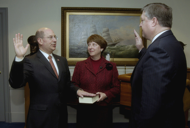 The Honorable Dr. Donald C. Winter (left) is sworn in as the 74th Secretary of the Navy (SECNAV) by Michael B. Donley (right), Director, Administration and Management, Office of the Secretary of Defense (OSD), as Mrs. Linda Winter (center), Dr. Winterßs wife, holds the Bible during the ceremony inside the Pentagon, Washington DC