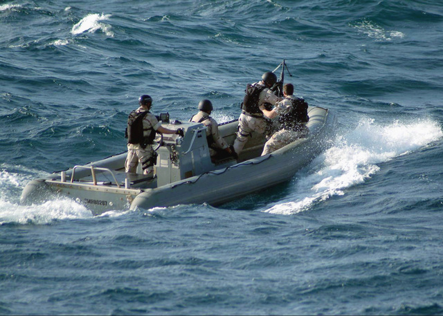 A boarding team from the US Navy (USN) Arleigh Burke class guided missile destroyer USS WINSTON S. CHURCHILL (DDG 81), onboard a RHIB (Rigid-Hull Inflatable Boat) approaches a suspected pirate vessel [not shown] to conduct a boarding and inspection at sea. After receiving a report of an attempted act of piracy from the International Maritime Bureau (IMB) in Kuala Lumpur on the morning of January 20th, the guided missile destroyer and other US naval forces in the area located this vessel controlled by suspected pirates and reported its position