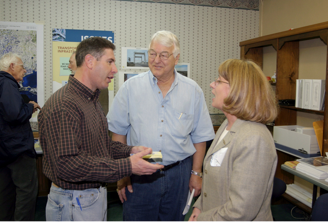 [Hurricane Katrina/Hurricane Rita] Abbeville, LA  January 21, 2006 - Clay Menard, Secretary/Treasurer of the Vermilion Parish Police Jury, talks over recovery strategy with local engineer Gene Sellers and Suzie Elkins, Director of the LA Office of Economic and Community Development.  Thirty-one meetings were held today in twenty-four parishes as part of a program organized jointly by FEMA and the State to solicit citizen input on reconstruction.  Photo by Greg Henshall / FEMA